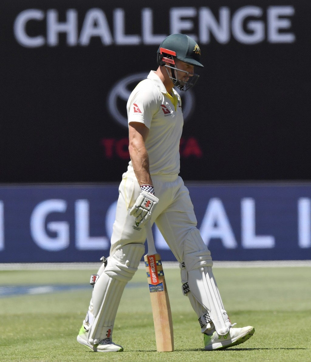 Australia's Shaun Marsh walks off after England's Stuart Broad trapped him LBW for 61 runs during the second day of their Ashes cricket test match in ...