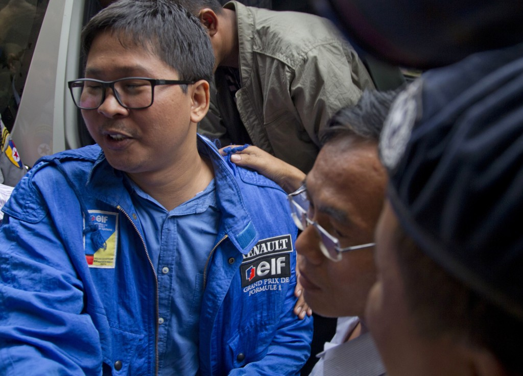 Reuters journalist Thet Oo Maung Maung, known as Wa Lone, exits a police van as he arrives for a court appearance Wednesday, Dec. 27, 2017, outside Ya...