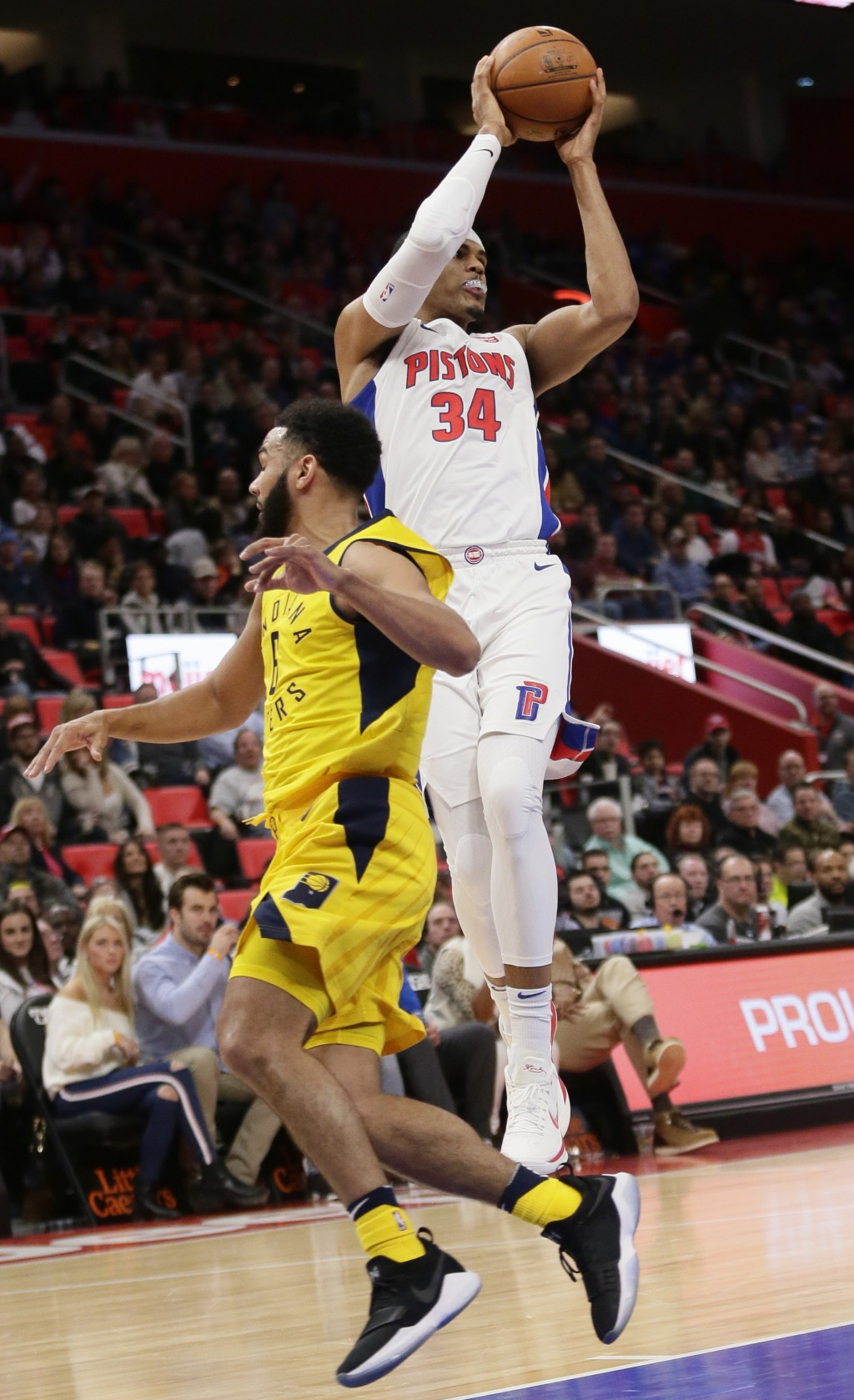 Detroit Pistons forward Tobias Harris (34) passes the ball against Indiana Pacers guard Cory Joseph during the first half of an NBA basketball game Tu...
