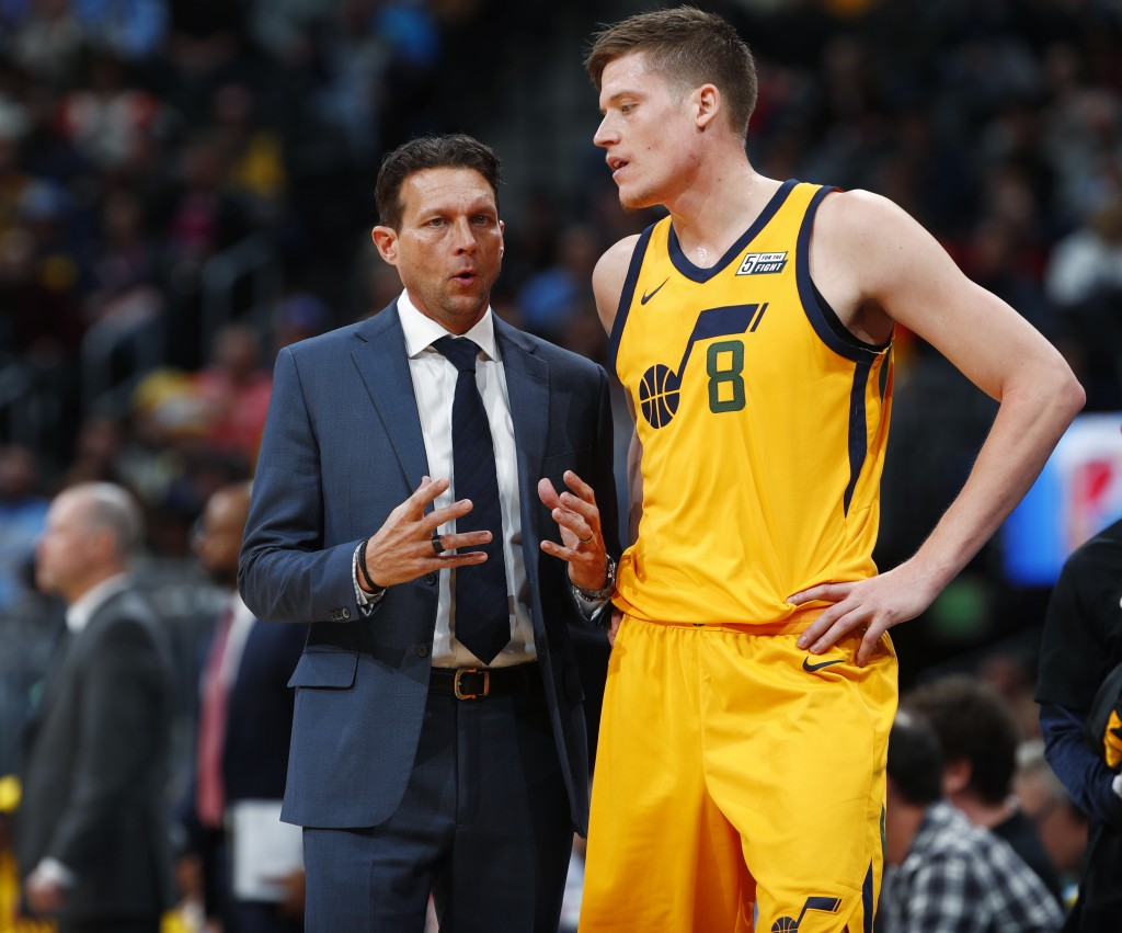 Utah Jazz head coach Quin Snyder, left, confers with forward Jonas Jerebko, of Sweden, during a break in the first half of an NBA basketball game agai...