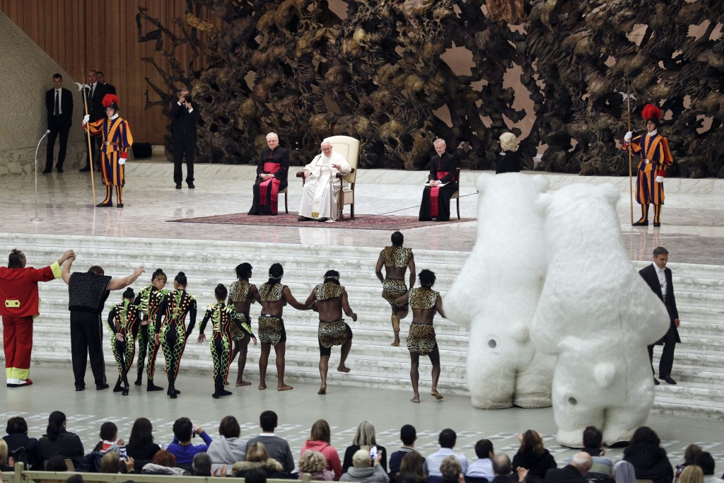 Artists of the Golden Circus perform in front of Pope Francis during his weekly general audience, in the Pope Paul VI hall, at the Vatican, Wednesday,...