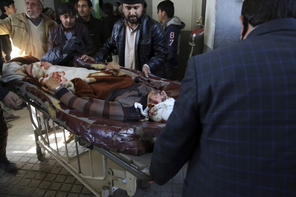 People carry an injured man into a hospital after a suicide attack in Kabul, Afghanistan, Thursday, Dec. 28, 2017. Authorities say attackers stormed t...
