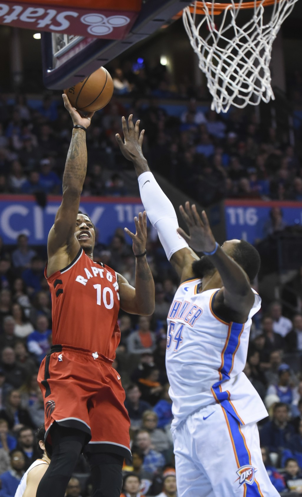 Toronto Raptors' DeMar DeRozan (10) shoots over Oklahoma City Thunder's Patrick Patterson (54) during the second quarter of an NBA basketball game in ...