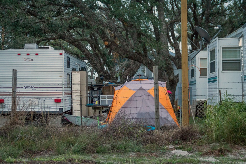 In this Dec. 15, 2017 photo provided by Kim Porter, shows people living in tents and trailers in Rockport, Texas. The federal government typically spe...