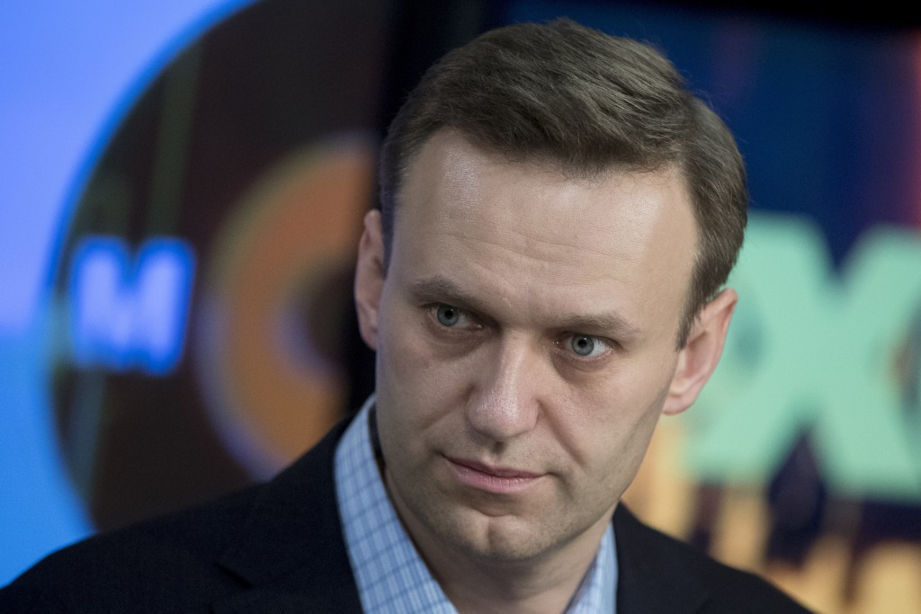 Russian opposition activist Alexei Navalny pauses, at the Echo Moskvy (Echo of Moscow) radio station in Moscow, Russia, Wednesday, Dec. 27, 2017. (AP ...
