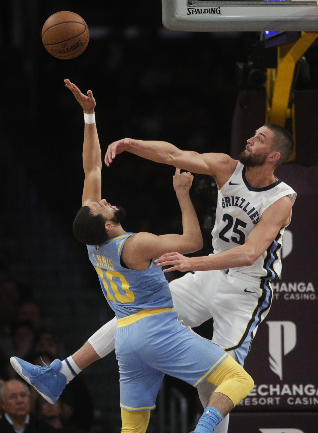 Los Angeles Lakers' Tyler Ennis, left, has his shot blocked by Memphis Grizzlies' Chandler Parsons during the first half of an NBA basketball game, We...