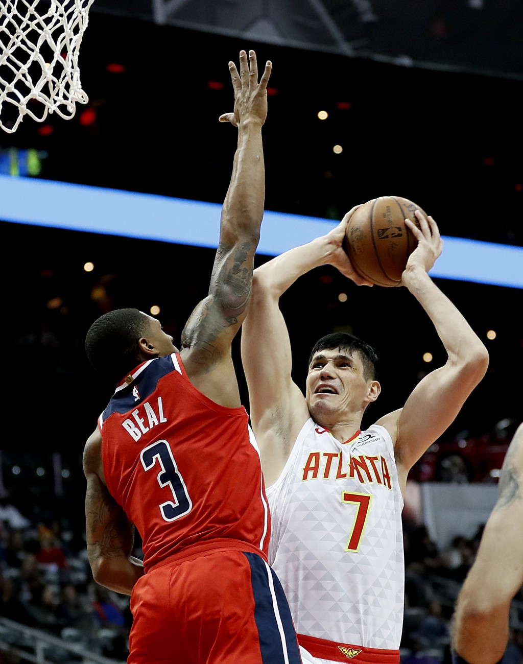 Atlanta Hawks' Ersan Ilyasova (7), of Turkey, shoots against Washington Wizards' Bradley Beal in the second quarter of an NBA basketball game in Atlan...