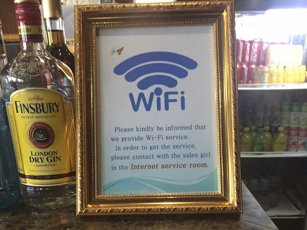 This Dec. 23, 2017, photo, shows a sign for the new WiFi service being offered in the departures lobby of Pyongyang's international airport. Despite b...