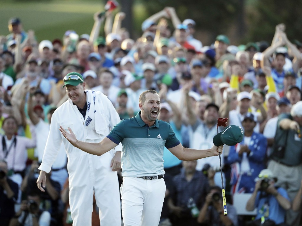 FILE - In this April 9, 2017, file photo, Sergio Garcia, of Spain, reacts after making his birdie putt on the 18th green to win the Masters golf tourn...