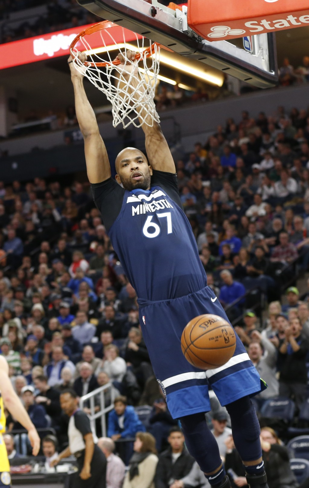Minnesota Timberwolves' Taj Gibson dunks against the Denver Nuggets in the first half of an NBA basketball game, Wednesday, Dec. 27, 2017, in Minneapo...