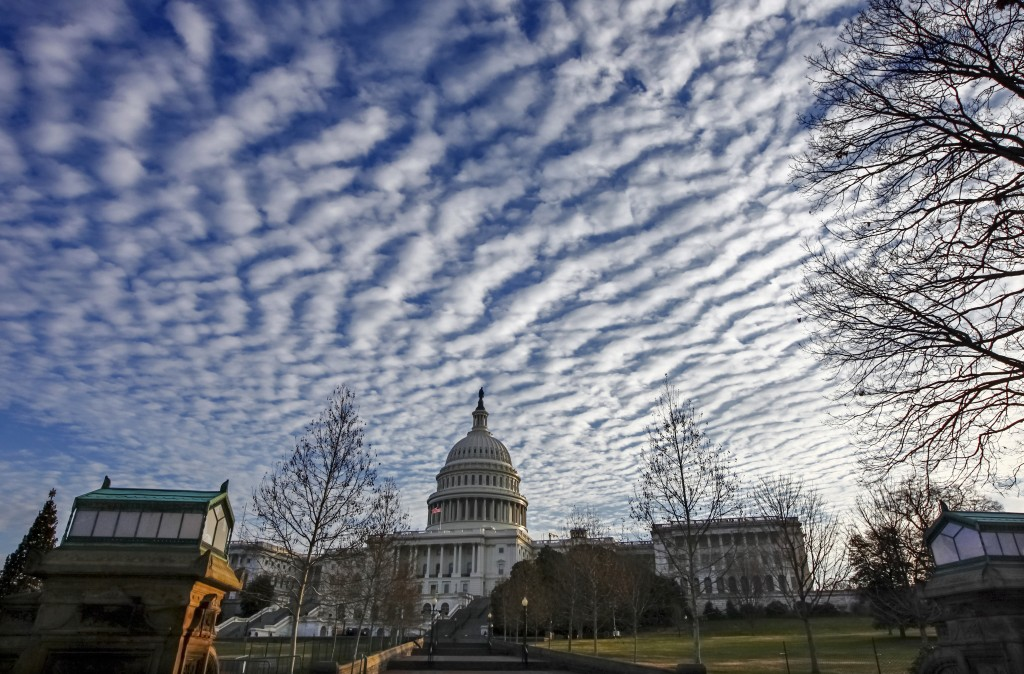 FILE - In this Dec. 22, 2017, file photo. the U.S. Capitol in the early morning in Washington. Donald Trump's unpredictable, pugnacious approach to th...