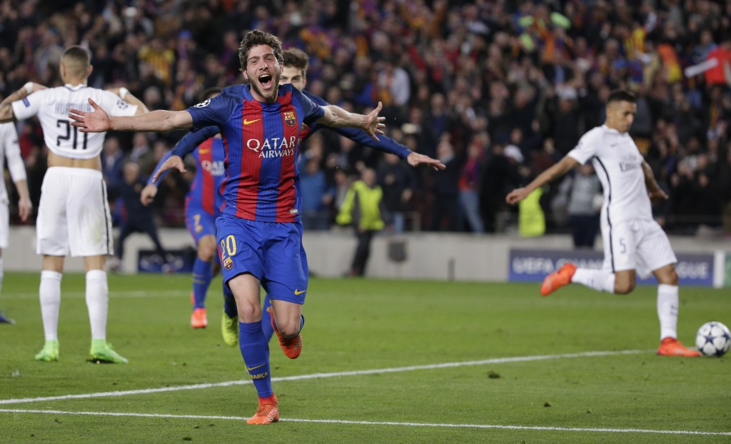 FILE - In this March 8, 2017, file photo, Barcelona's Sergi Roberto celebrates after scoring their sixth goal during a Champions League round of 16, s...