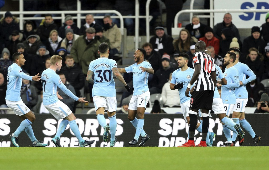 Manchester City's Raheem Sterling, center, celebrates with teammates after scoring his side's first goal of the game during their English Premier Leag...