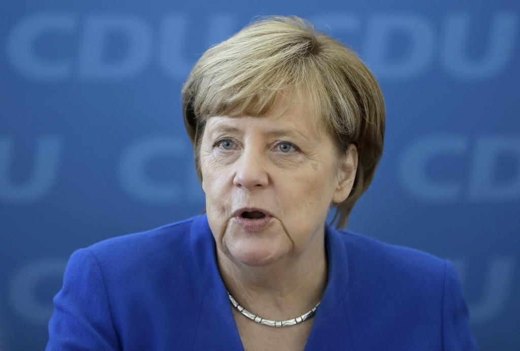 FILE - In this Oct. 16, 2017 file photo German Chancellor and chairwoman of the German Christian Democratic Party (CDU), Angela Merkel, speaks at the ...