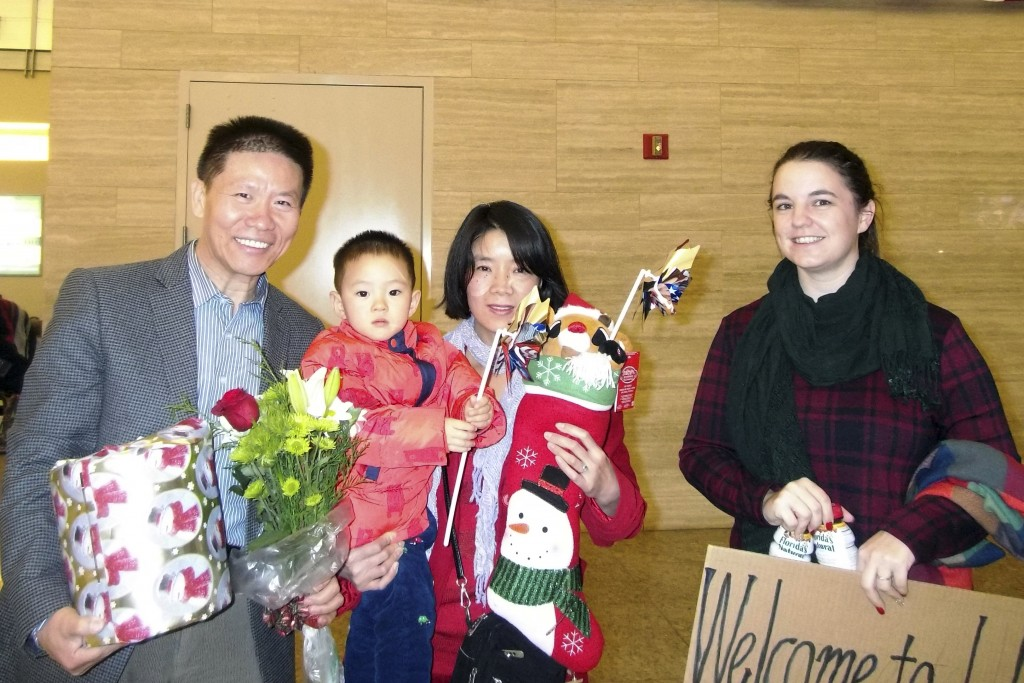 In this photo taken early morning of Dec 24, 2017 and released by China Aid, Li Aijie, center in red with her son Li Mutian poses for a photo with Bob...