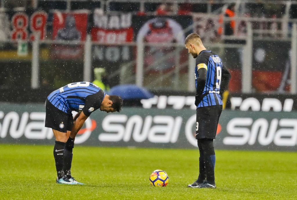 Inter Milan's captain Mauro Icardi, right, and teammate Martins Eder react after AC Milan's Patrick Cutrone, not shown, scored for his team during an ...
