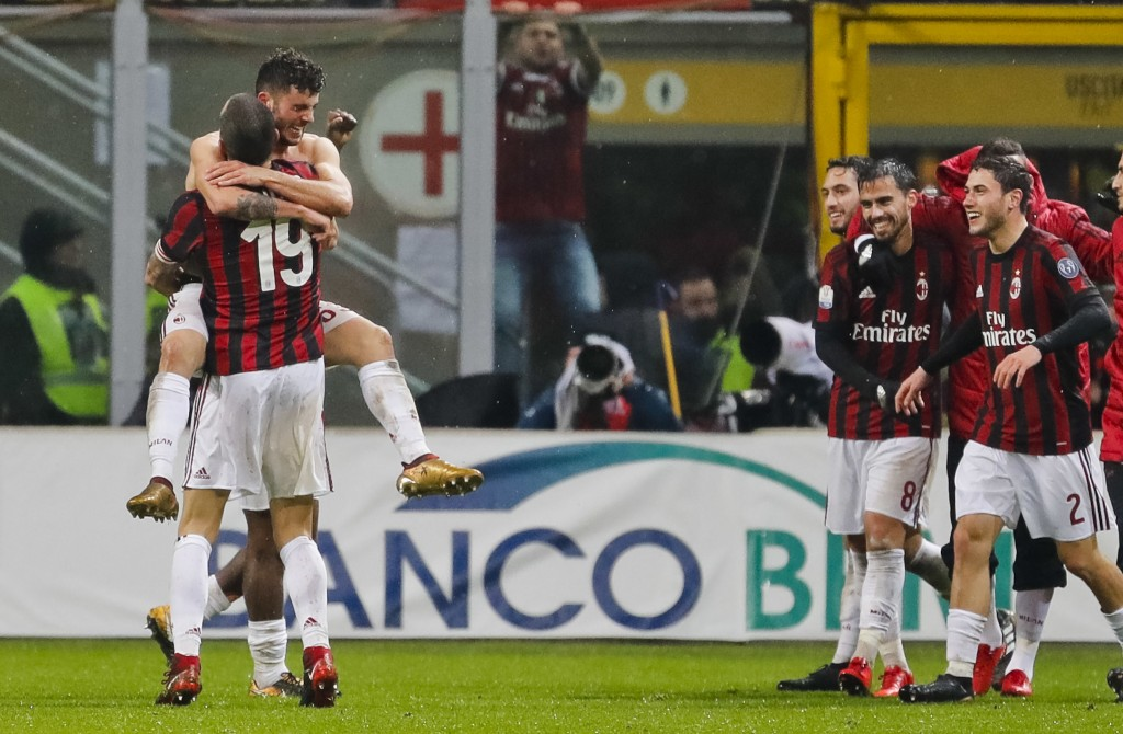 AC Milan's Patrick Cutrone, left front to camera, celebrates with his teammates after scoring for his team during an Italian Cup quarter-final soccer ...