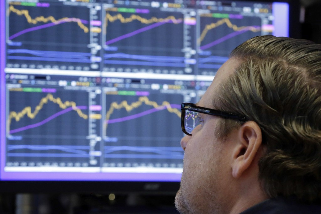FILE - In this Monday, Dec. 4, 2017, file photo, specialist Gregg Maloney works at his post on the floor of the New York Stock Exchange. The stock mar...