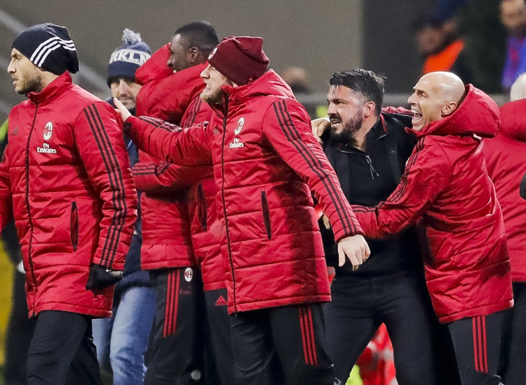 AC Milan coach Gennaro Gattuso, second from right, celebrates at the end of an Italian Cup quarter-final soccer match between Milan and Inter Milan at...