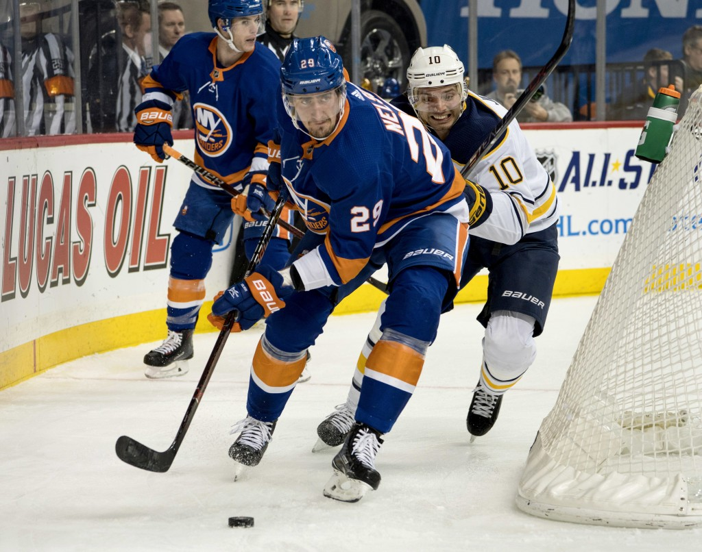 New York Islanders' Brock Nelson (29) takes control of the puck past the Buffalo Sabres' Jacob Josefson during the 1st period of an NHL hockey game, W...