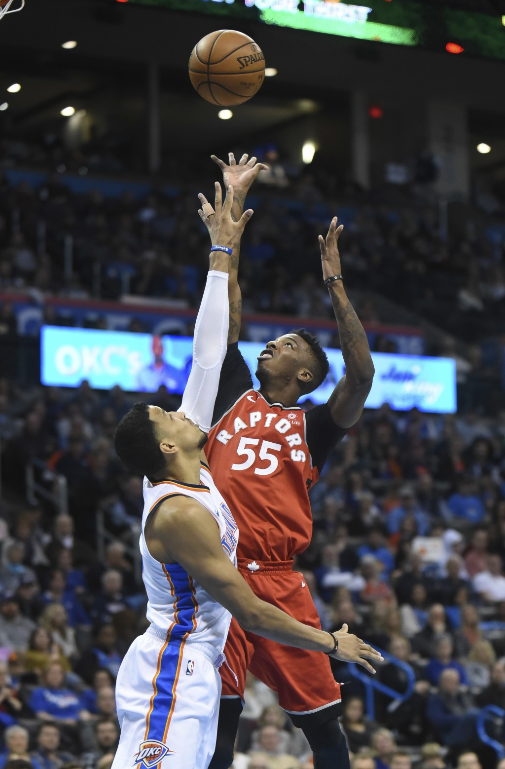 Toronto Raptors' Delon Wright (55) shoots over Oklahoma City Thunder's Andre Roberson during the second quarter of an NBA basketball game in Oklahoma ...