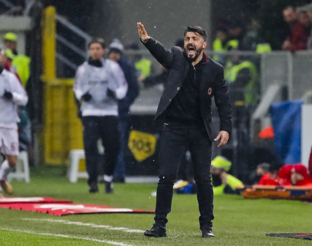 AC Milan coach Gennaro Gattuso gives instructions to his players during an Italian Cup quarter-final soccer match between Milan and Inter Milan at the...