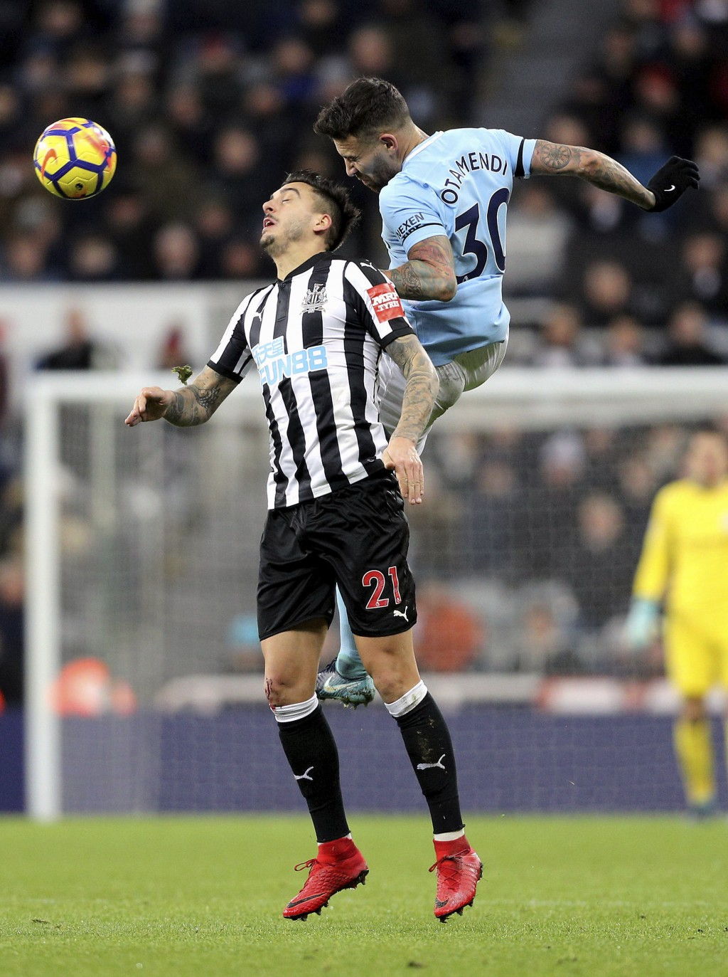 Newcastle United's Joselu, left, and Manchester City's Nicolas Otamendi battle for the ball during their English Premier League soccer match at St Jam...