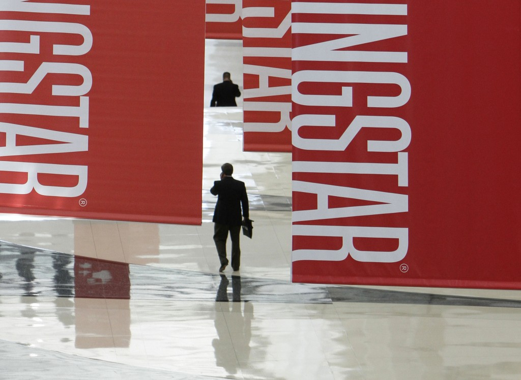 FILE - In this Thursday, June 24, 2010, file photo, attendees of a Morningstar investment conference walk beneath banners at the McCormick Center in C...