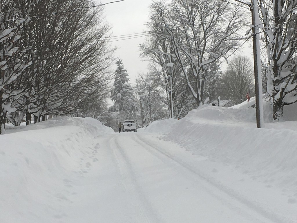 In this Tuesday, Dec. 26, 2017 photo, a truck stopped at the top of a hill after heavy snow fell in Cassadaga, N.Y. The National Weather Service said ...