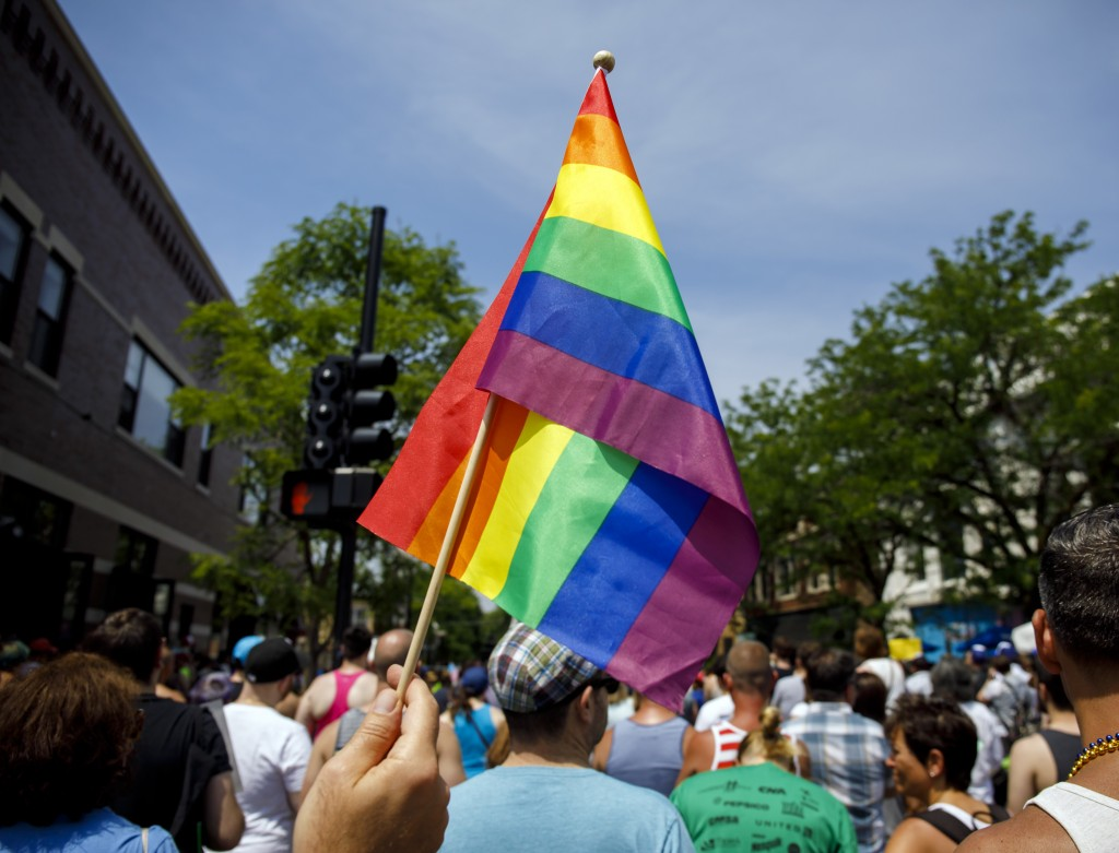 FILE - In this June 11, 2017 file photo people attend the LGBTQ Chicago Equality rally in the Andersonville neighborhood of Chicago. Starting in Janua...