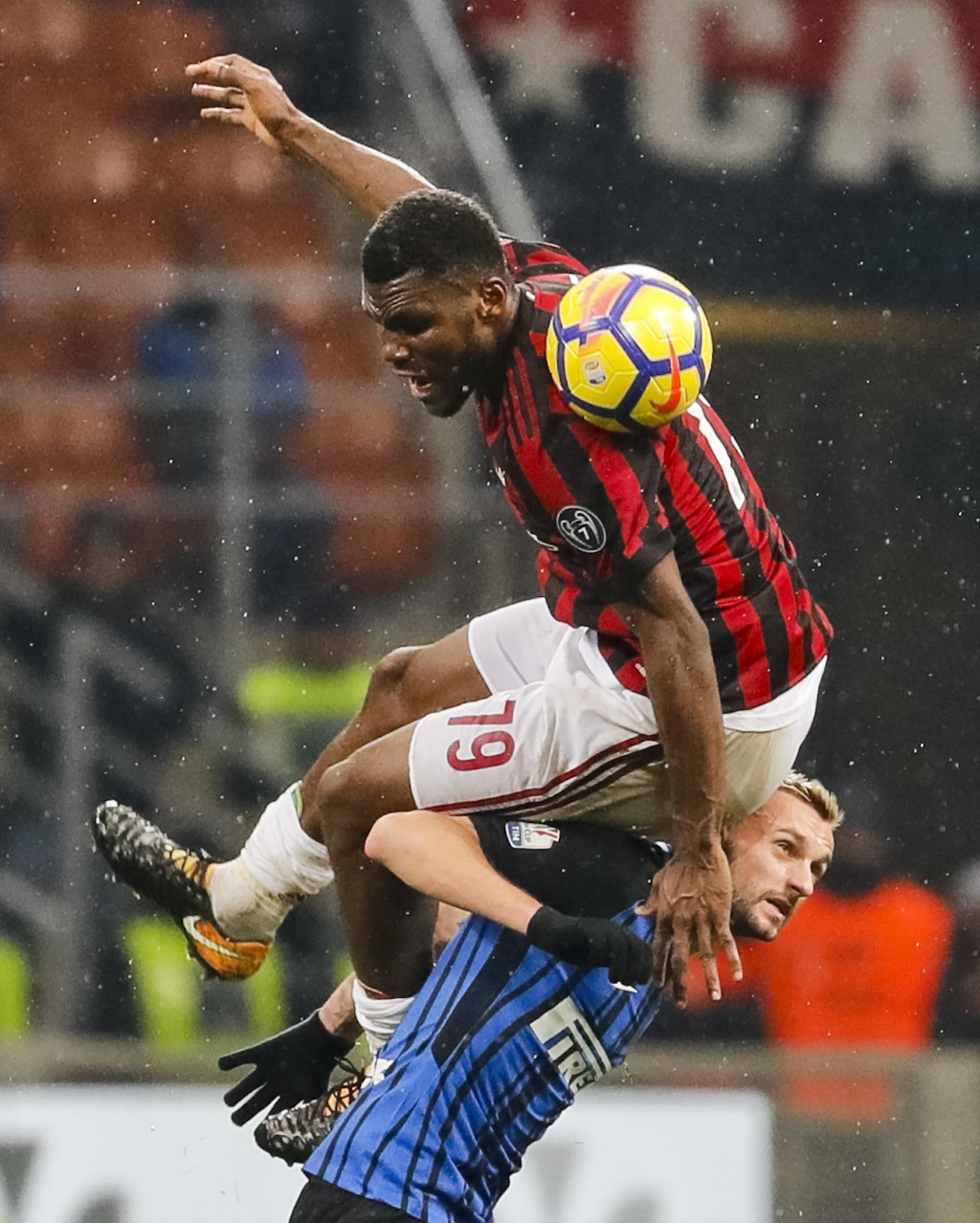 AC Milan's Franck Kessie, top, jumps for a ball over Inter Milan's Marcelo Brozovic during an Italian Cup quarter-final soccer match between Milan and...