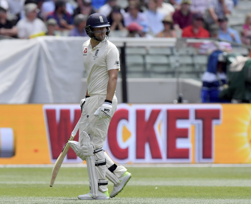 England's Dawid Malan walks off after he was adjudged LBW off the bowling of Australia's Josh Hazlewood for 14 runs during the third day of their Ashe...