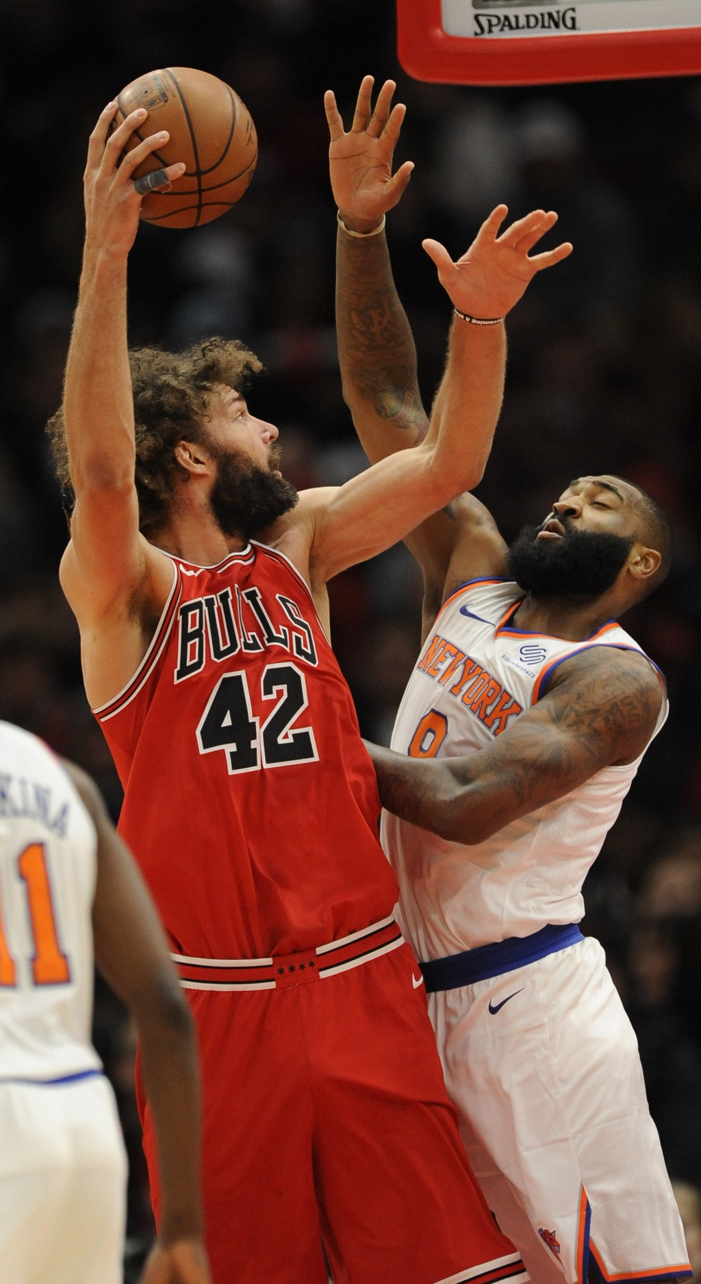 Chicago Bulls' Robin Lopez (42) goes up to shoot against New York Knicks' Kyle O'Quinn (9) during the first half of an NBA basketball game Wednesday, ...