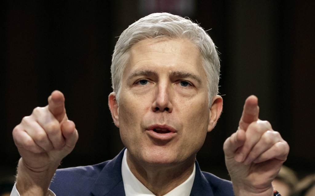 FILE - In this March 22, 2017, file photo, then-Supreme Court nominee Judge Neil Gorsuch speaks during his confirmation hearing, on Capitol Hill in Wa...