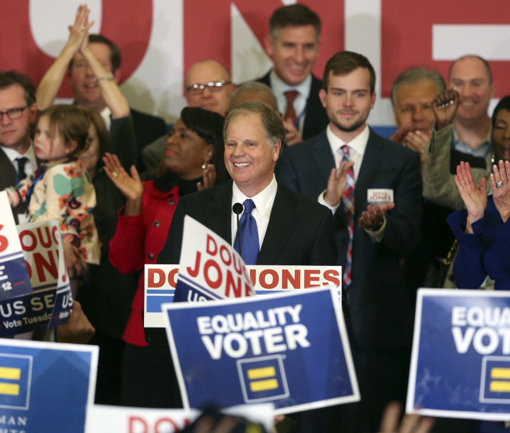 FILE - In this Tuesday, Dec. 12, 2017 file photo, Democrat Doug Jones speaks in Birmingham, Ala.  Roy Moore is going to court to try to stop Alabama f...