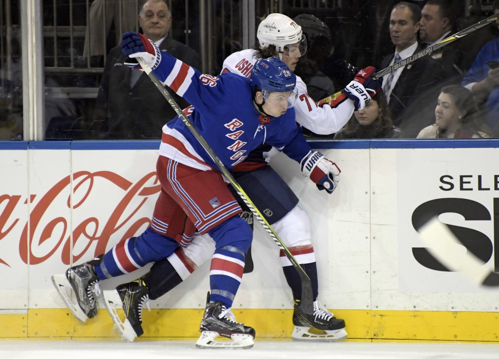 New York Rangers left wing Jimmy Vesey (26) checks Washington Capitals right wing T.J. Oshie (77) during the second period of an NHL hockey game, Wedn...