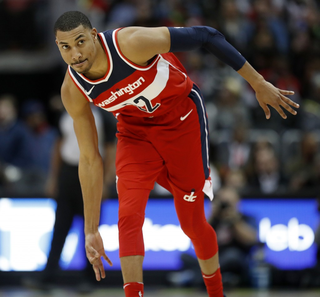 Washington Wizards' Otto Porter Jr., gestures after hitting a three-point basket in the second quarter of an NBA basketball game against the Atlanta H...