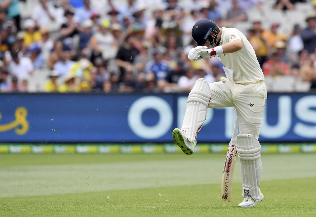 England's Joe Root kicks at the ground after he was caught out for 61 runs against Australia during the third day of their Ashes cricket test match in...