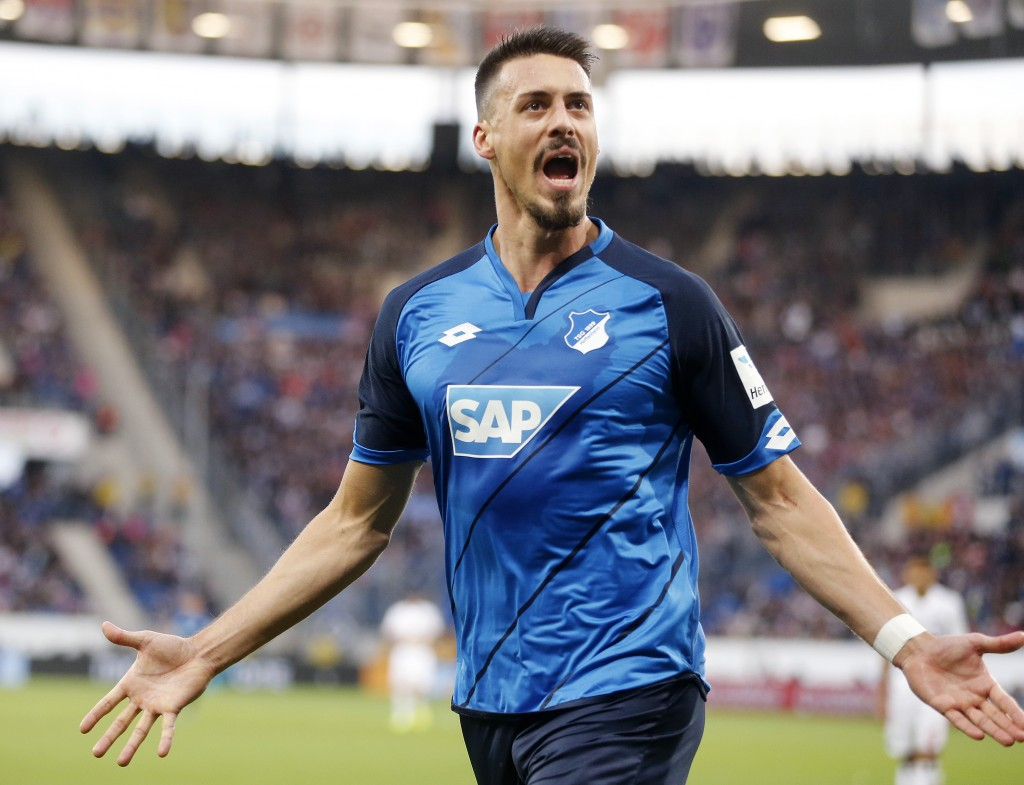 FILE - In this Nov. 20, 2016 file photo Hoffenheim's Sandro Wagner celebrates his side's equalizing goal during a German first division Bundesliga soc...