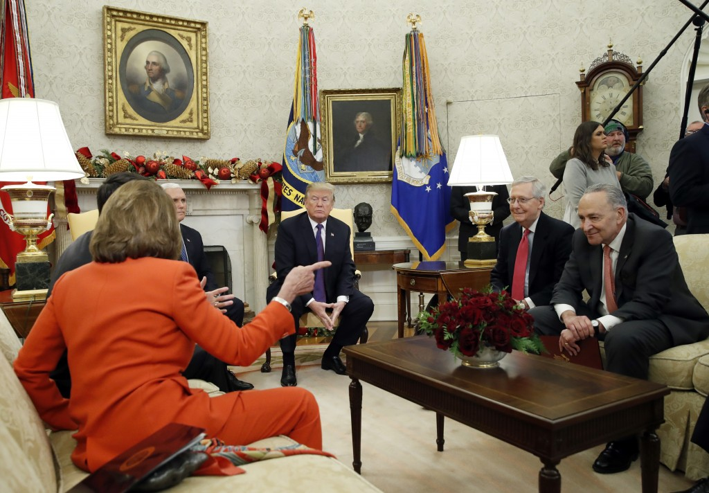 FILE - In this Dec. 7, 2017, file photo, President Donald Trump accompanied by Vice President Mike Pence, listens as House Minority Leader Nancy Pelos...