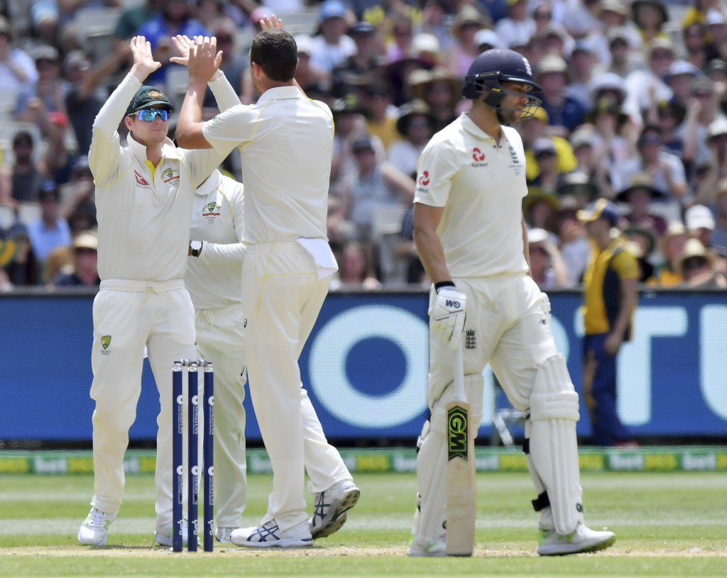 Australia's Steve Smith, left, congratulates Josh Hazlewood after England's Dawid Malan, right, was adjudged LBW for 14 runs during the third day of t...