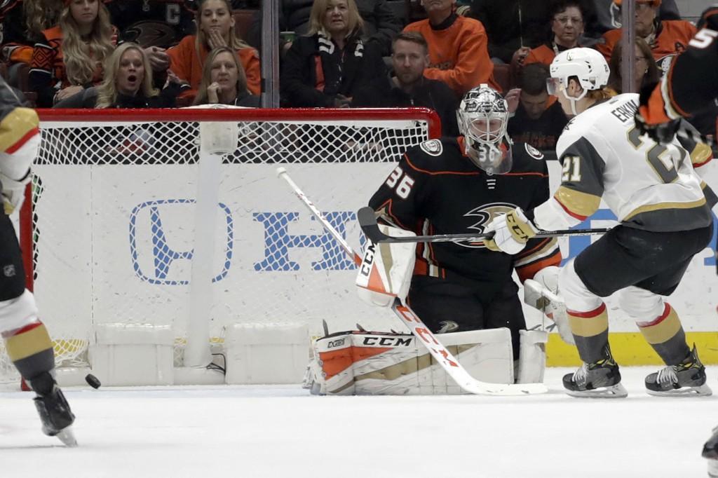 Vegas Golden Knights center Cody Eakin scores past Anaheim Ducks goalie John Gibson during the second period of an NHL hockey game in Anaheim, Calif.,...