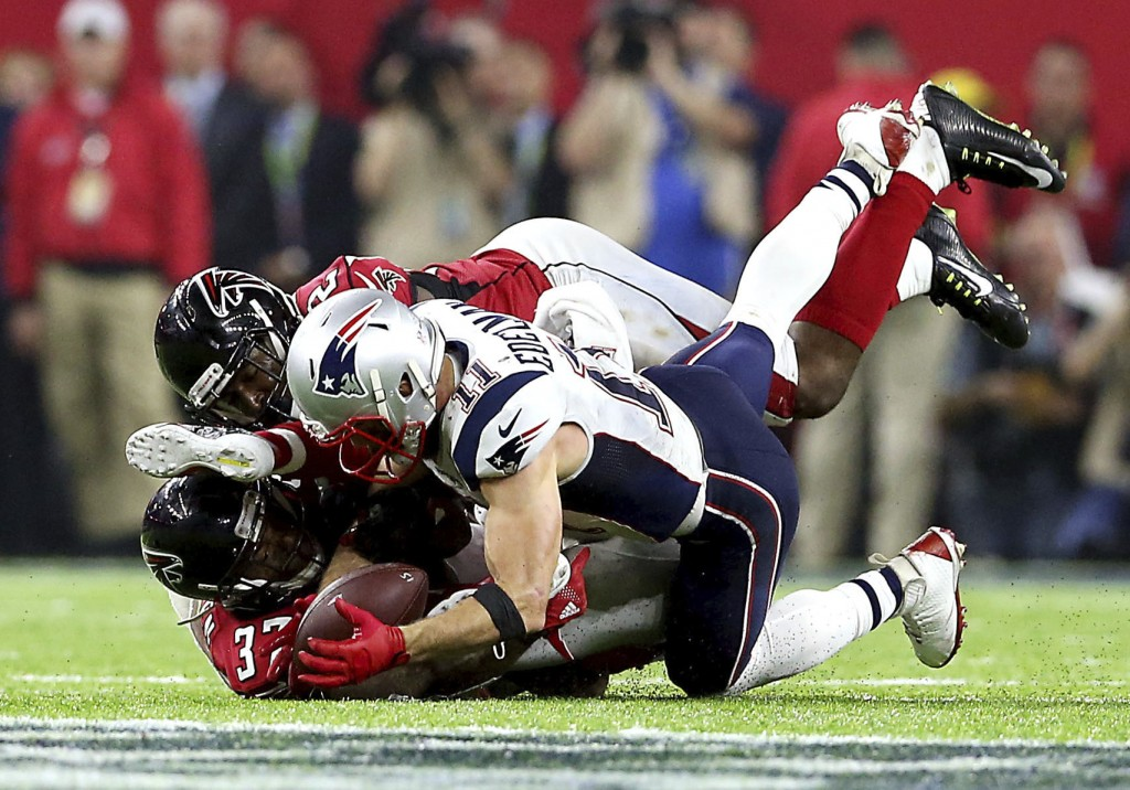 FILE - In this Feb. 5, 2017, file photo, New England Patriots Julian Edelman (11) makes a catch against the Atlanta Falcons during NFL football's Supe...
