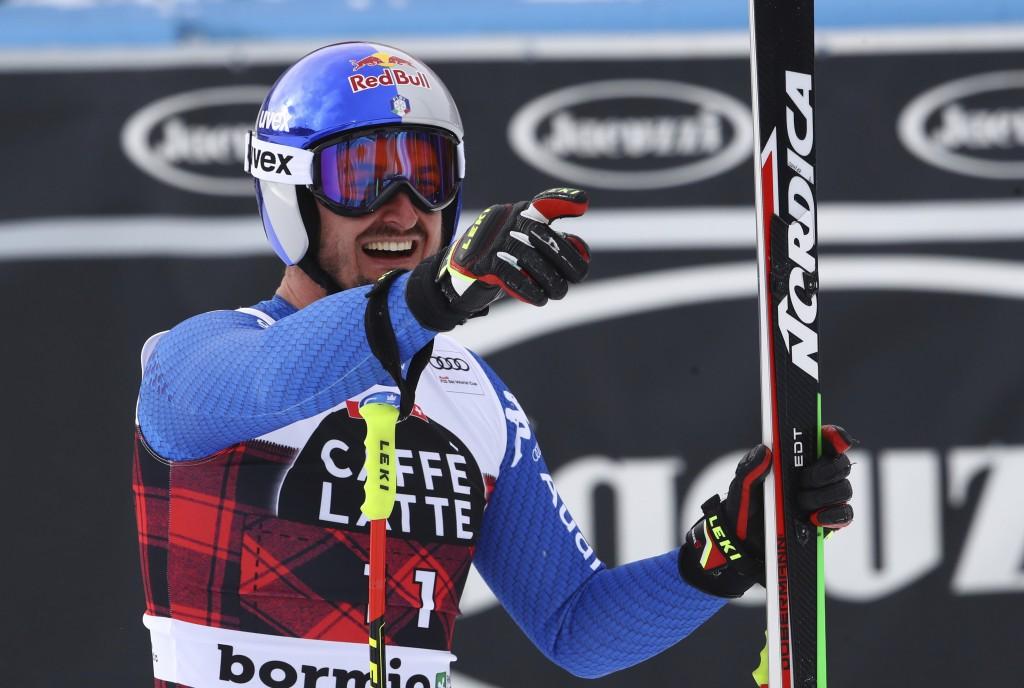 Italy's Dominik Paris celebrates in the finish area of an alpine ski, men's World Cup downhill, in Bormio, Italy, Thursday, Dec. 28, 2017. (AP Photo/A...