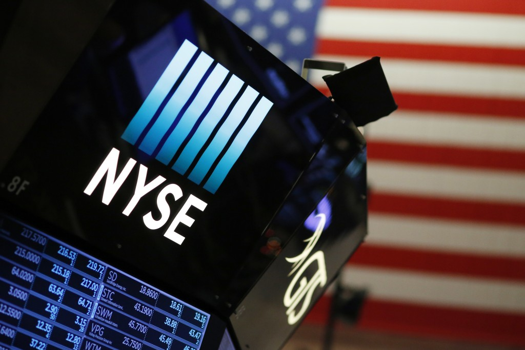 FILE - In this Wednesday, Dec. 27, 2017, file photo, a logo for the New York Stock Exchange is displayed above the trading floor. Stocks are rising at...