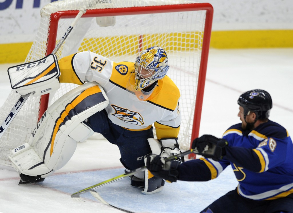 Nashville Predators goalie Pikka Rinne (35), of Finland, guards against St. Louis Blues' Kyle Brodziak (28) during the third period of an NHL hockey g...