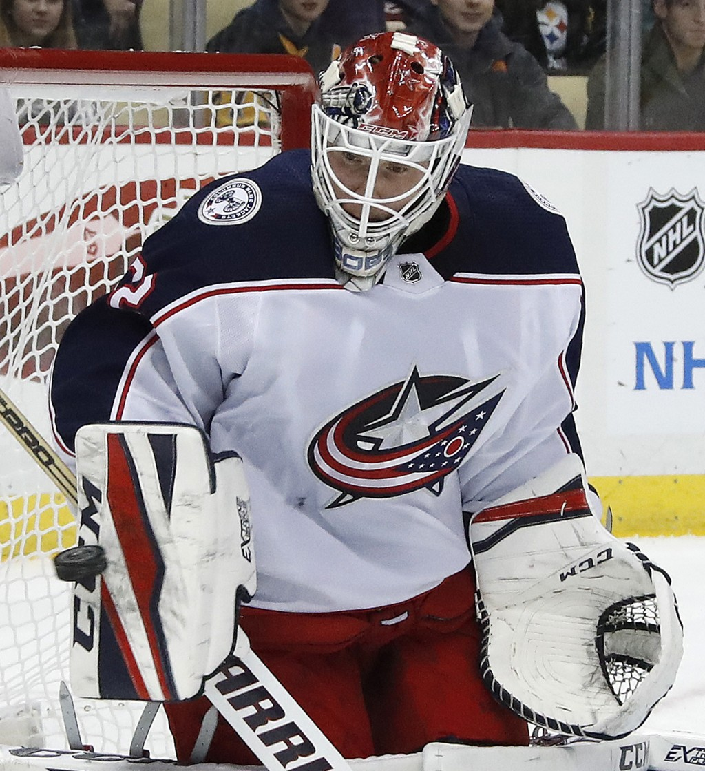 Columbus Blue Jackets goalie Sergei Bobrovsky blocks a shot during the second period of an NHL hockey game against the Pittsburgh Penguins in Pittsbur...