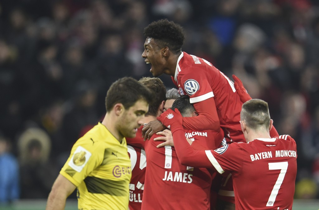 FILE - In this Dec. 20, 2017 file photo, Munich's players, David Alaba on top, celebrate the 2-0 goal during the German DFB (German Football Federatio...