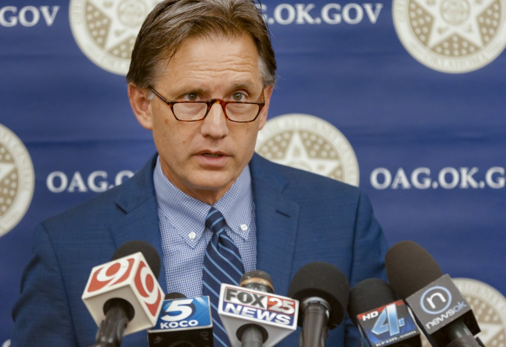 FILE - In this June 30, 2017, file photo, Oklahoma Attorney General Mike Hunter speaks during a news conference in Oklahoma City. With one of the busi...