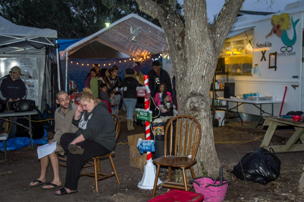 In this Dec. 15, 2017 photo provided by Kim Porter, people are waiting for their name to be called for food and snack distribution at the Rockport Rel...